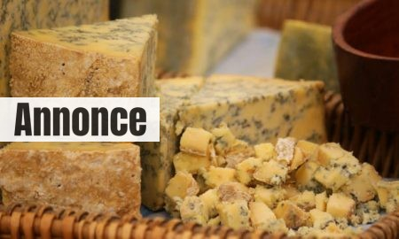 Stock photo of gourmet dairy food market chunks of Stilton cheese / soft crumbly, creamy white blue cheese pieces and cubes to sample, taste and test in basket, made with Penicillium roqueforti mould / mold fungus to make blue veins, like Roquefort / Gorgonzola